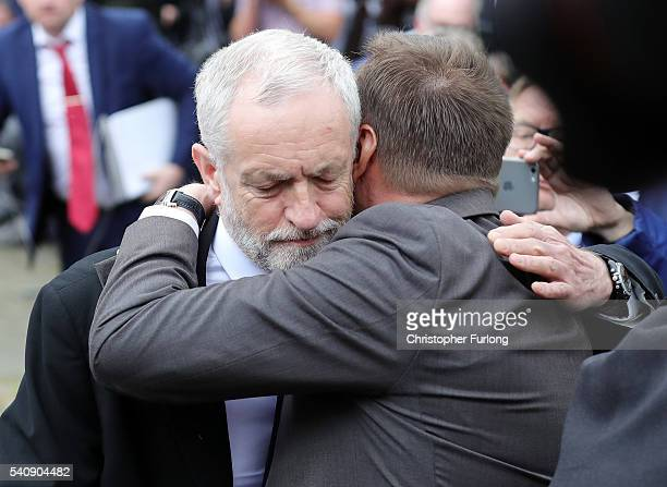 Labour Leader Jeremy Corbyn embraces Jason McCartney MP for Colne Valley in West Yorkshire as they pay their respects near to the scene of the murder...