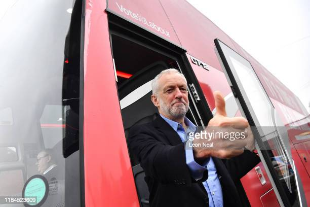 Labour leader Jeremy Corbyn gestures from the party's campaign bus as he arrives for a Labour event in Renishaw on November 25, 2019 in Derbyshire,...