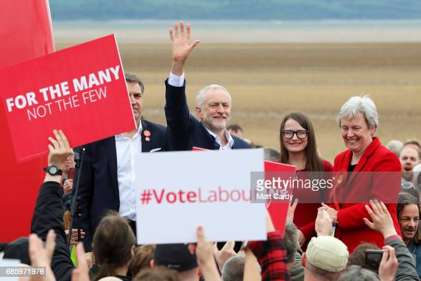 Labour Leader Jeremy Corbyn greets supporters as Labour Parliamentary Candidate for Wirral West Margaret Greenwood looks on during a campaign visit...