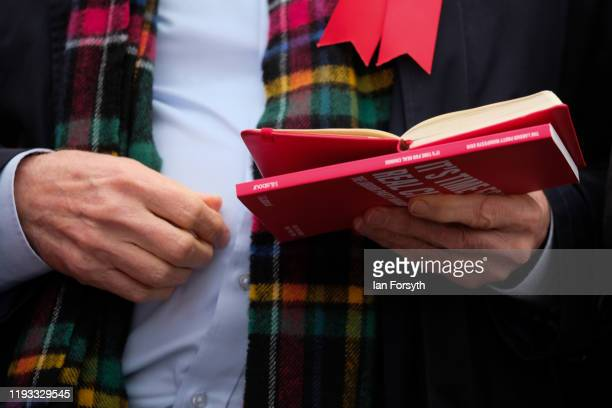 Labour leader Jeremy Corbyn holds his notebook and party manifesto before he speaks to supporters during a stump speech at the Sporting Lodge Inn on...