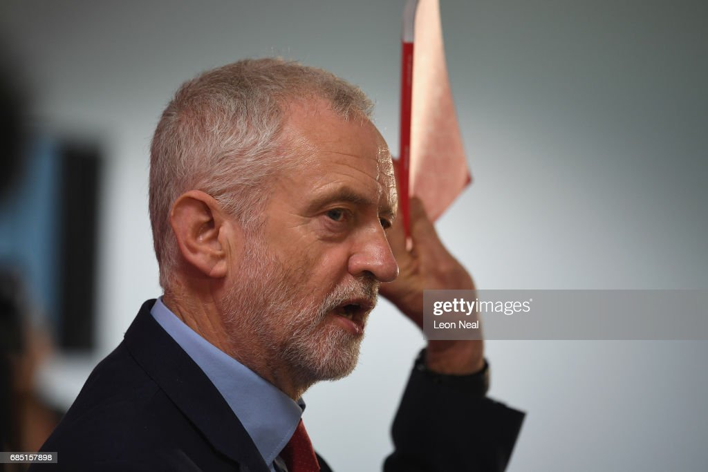 Labour leader Jeremy Corbyn holds Labour's manifesto as he speaks on May 19, 2017 in Peterborough, England. Britain goes to the polls on June 8 to elect a new parliament in a general election.