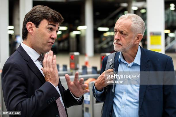 Labour Leader Jeremy Corbyn is greeted by Mayor of Greater Manchester Andy Burnham as he arrives at Manchester Victoria Station from Liverpool during...