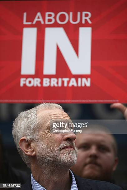 Labour Leader Jeremy Corbyn listens as former leader Ed Miliband addresses supporters and members of the public in Doncaster town centre on May 27...