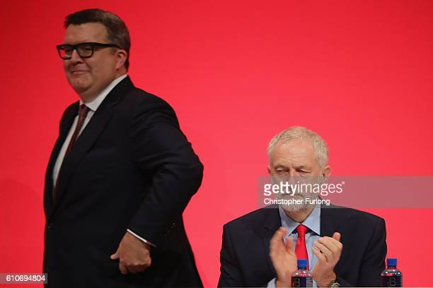 Labour leader Jeremy Corbyn looks on as Deputy leader of the Labour party Tom watson walks to the podium to deliver his keynote speech to delegates...