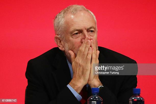 Labour leader Jeremy Corbyn looks on as Shadow home secretary Andy Burnham delivers his keynote speech to delegates at the ACC on September 28 2016...