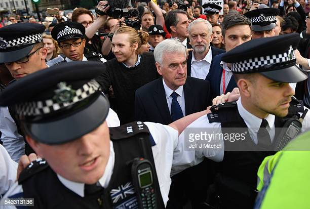 Labour Leader Jeremy Corbyn makes his way through the crowd with Shadow Chancellor of the Exchequer John McDonnell during Momentum's 'Keep Corbyn'...