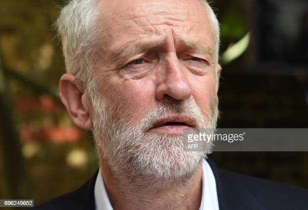 Labour leader Jeremy Corbyn meets staff and volunteers at St Clement's Church in west London on June 15 2017 who have provided shelter and support...