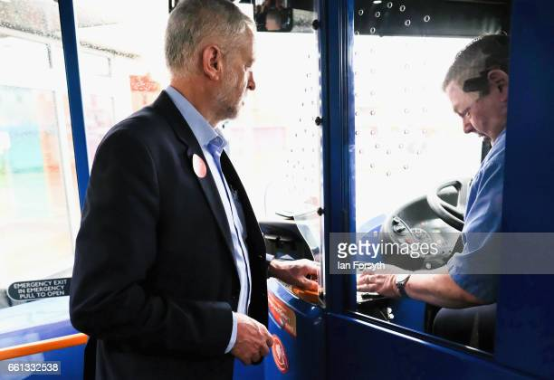 Labour leader Jeremy Corbyn pays his fair as he takes a ride on the number 36 bus from Middlesbrough to Stockton on Tees on March 31 2017 in...