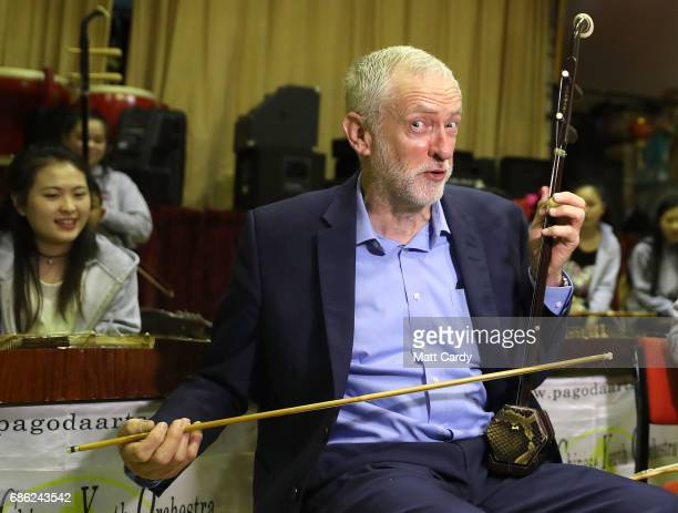 Labour Leader Jeremy Corbyn plays an Er hu a Chinese violin during a visit to the Pagoda Arts and the Wah Sing Chinese Community centre as he...