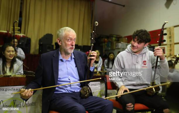 Labour Leader Jeremy Corbyn plays an Er hu a Chinese violin with Charlie wardle during a visit to the Pagoda Arts and the Wah Sing Chinese Community...