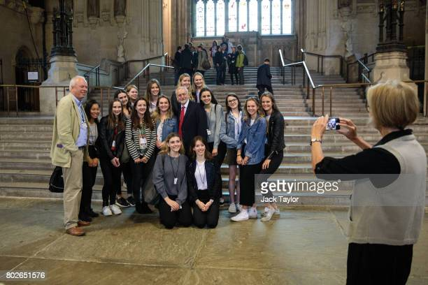 Labour Leader Jeremy Corbyn poses for a photograph with pupils from Guildford High School in Westminster Hall in the Houses of Parliament on June 28...