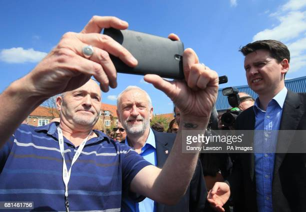 Labour leader Jeremy Corbyn poses for a selfie while on the general election campaign trail at Garforth Leisure Centre Leeds