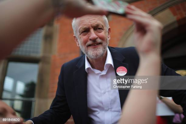Labour leader Jeremy Corbyn poses for a selfie with a supporter at a campaign rally at Hucknall Market Place as he visits the East Midlands during...
