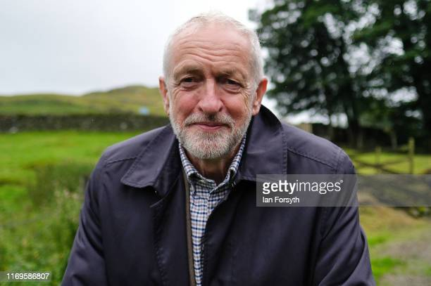 Labour Leader Jeremy Corbyn poses for media photographs as he visits the Rakefoot sheep farm in Cumbria on August 22 2019 in Keswick England The...