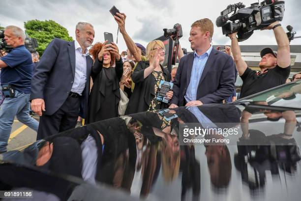 Labour leader Jeremy Corbyn poses for selfies with supporters after a rally at Beeston Youth and Community Centre as he visits the East Midlands...