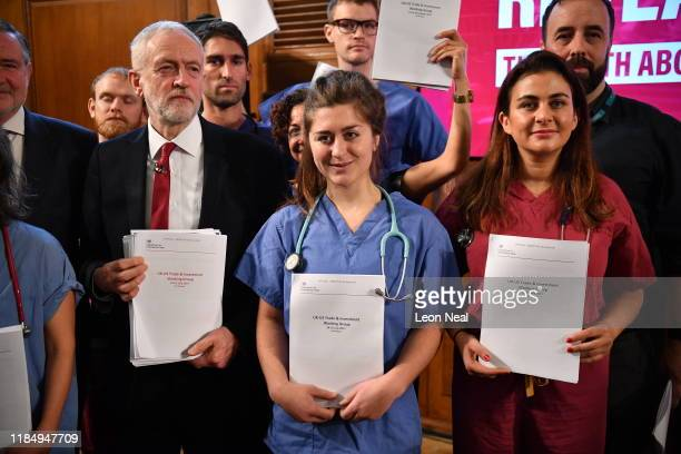 Labour leader Jeremy Corbyn poses with members of NHS staff as he presents documents related to postBrexit UKUS Trade talks during an election policy...