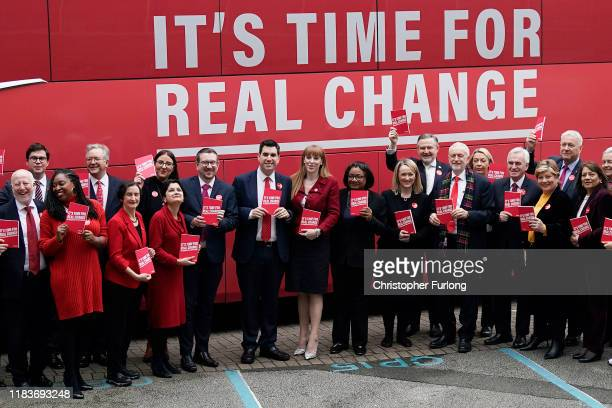 Labour leader Jeremy Corbyn poses with members of the shadow cabinet outside the campaign bus as he arrives to launch the party's election manifesto...