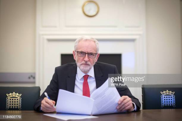 Labour leader Jeremy Corbyn poses with the Political Declaration setting out the framework for the future UKEU relationship in his office in the...