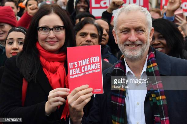 Labour leader Jeremy Corbyn poses with their manifesto as he campaigns in Thurrock on November 24, 2019 in Thurrock, England.