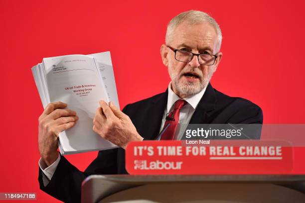 Labour leader Jeremy Corbyn presents documents related to UKUS Trade talks as he speaks during an election policy announcement on the NHS at church...