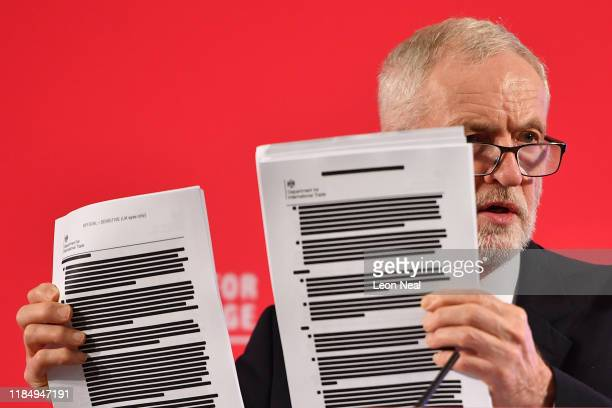 Labour leader Jeremy Corbyn presents redacted documents as he speaks during an election policy announcement on the NHS at church house n Westminster...