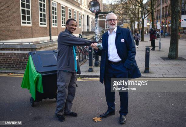 Labour Leader Jeremy Corbyn shakes a street cleaner's wrist at Birkbeck College SOAS University of London on December 03 2019 in London England The...