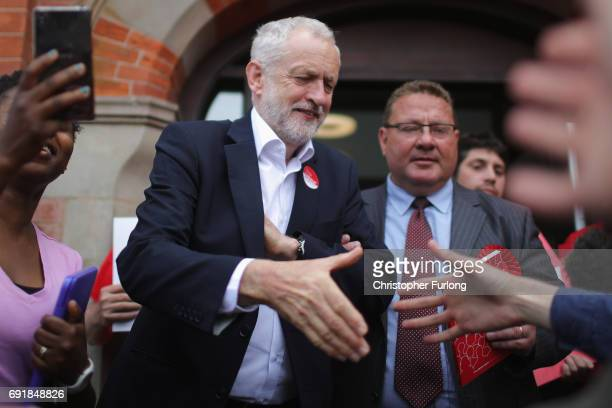 Labour leader Jeremy Corbyn shakes hands with supporters at a rally at Hucknall Market Place as he visits the East Midlands during the final weekend...
