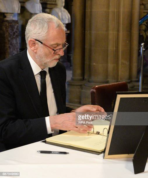 Labour leader Jeremy Corbyn signs a book of condolence at Manchester Town Hall on May 23 2017 in Manchester England A 23yearold man was arrested in...