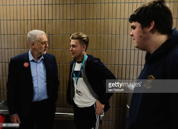 Labour leader Jeremy Corbyn speaks to students as he waits for the number 36 bus from Middlesbrough to Stockton on Tees on March 31 2017 in...