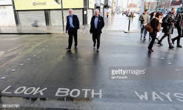 Labour leader Jeremy Corbyn speaks with Middlesbrough MP Andy McDonald as they walk through Stockton high street on March 31 2017 in Middlesbrough...