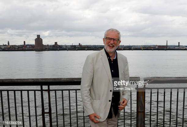 Labour leader Jeremy Corbyn stands by the River Mersey during a visit to outline plans for Labour's green industrial revolution in the North on July...
