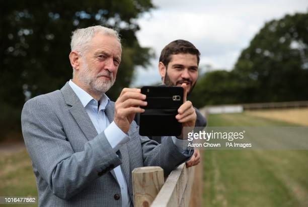 Labour leader Jeremy Corbyn takes a photo of Hands Free Hectare an autonomous harvester during his visit to Harper Adams University Newport Corbyn...