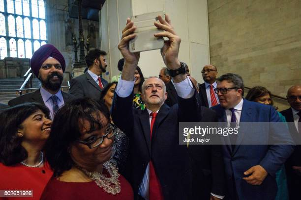 Labour Leader Jeremy Corbyn takes a selfie with Labour MPs in Westminster Hall in the Houses of Parliament on June 28 2017 in London England The...