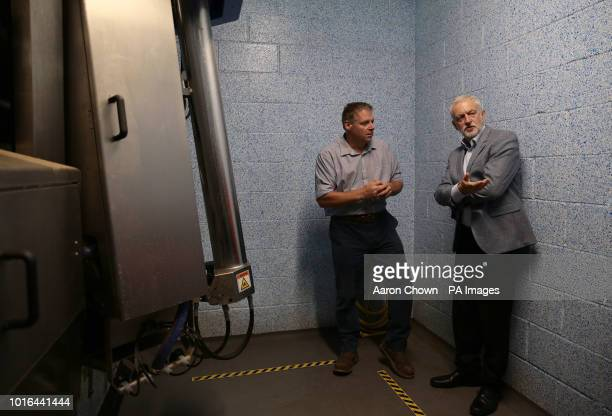 Labour leader Jeremy Corbyn talking to Farm Manager Scott Kirby at the Robotic Milking Parlour during his visit to Harper Adams University Newport...