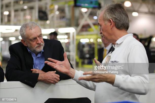 Labour Leader Jeremy Corbyn talks to master trimmer Tom Davies during a visit to luxury car maker Aston Martin on November 16 2017 in Warwick England...