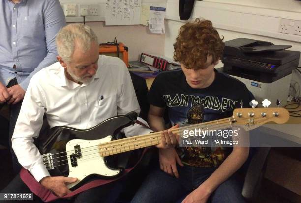 Labour leader Jeremy Corbyn tries a bass guitar at a community centre in Kilwinning North Ayrshire as part of campaigning to win back support in...