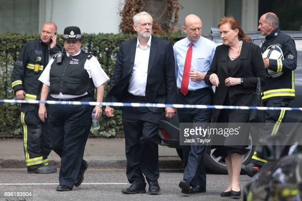 Labour leader Jeremy Corbyn visits the scene of the Grenfell Tower fire with new Labour MP for Kensington Emma Dent Coad on June 15 2017 in London...