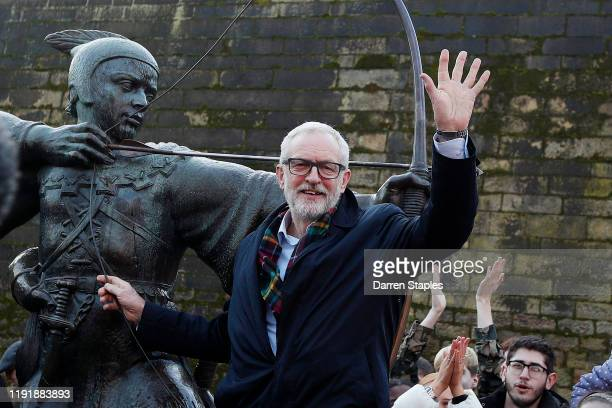 Labour Leader Jeremy Corbyn waves as he poses next to the Robin Hood statue during a General Election advertisement launch on December 04 2019 in...