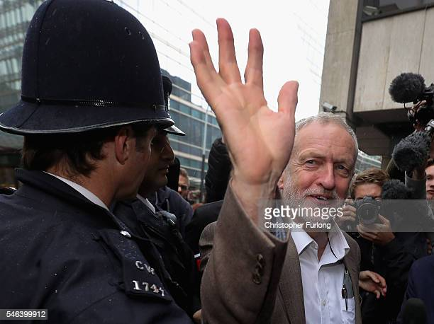 Labour leader Jeremy Corbyn waves to supporters as he arrives at the Labour Party's National Executive meeting on July 12 2016 in London England...