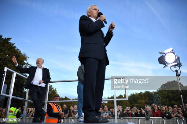 Labour leader Jeremy Corbyn waves to supporters as shadow chancellor John McDonnell speaks during a Momentum Rally on the eve of the Labour Party...