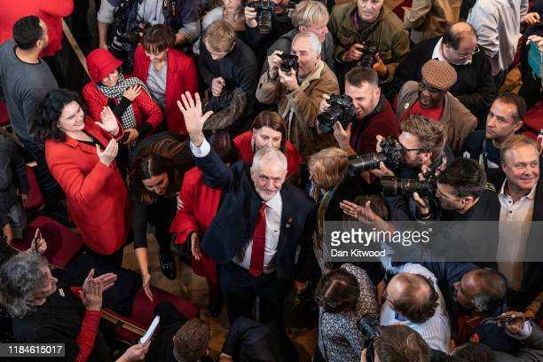 Labour leader Jeremy Corbyn waves to the photographers after speaking at an election campaign at Battersea Arts Centre on October 31 2019 in...