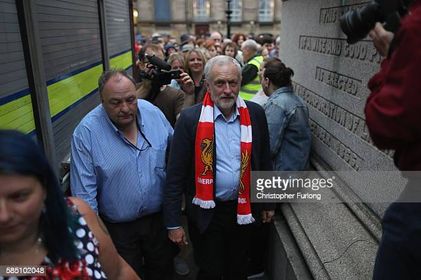 Labour Leader Jeremy Corbyn wears a Liverpool FC scarf given to him by a supporter after addressing thousands of people in St George's Square on...