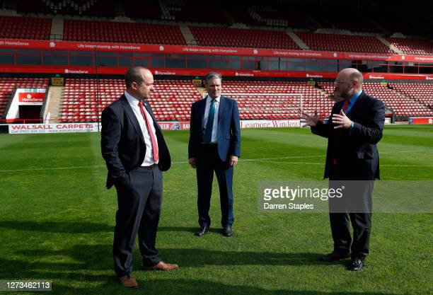 Labour Leader Keir Starmer speaks on the pitch with Member of Parliament Liam Byrne and club Chief Executive Stefan Gamble during a visit of Walsall...
