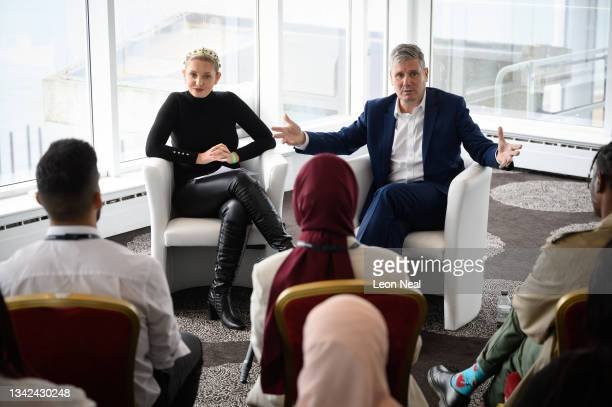 Labour Leader Keir Starmer speaks to former 'Love Island' star Amy Hart during a youth fringe meeting on September 25, 2021 in Brighton, United...