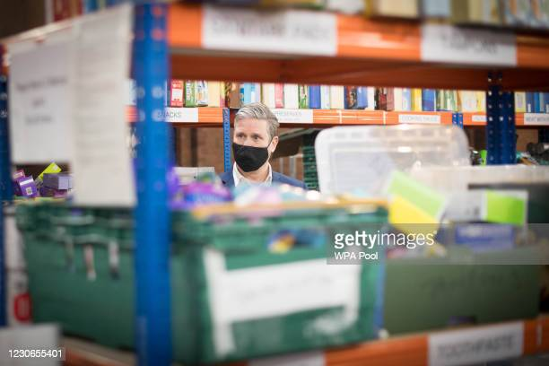 Labour leader Keir Starmer visits a food bank distribution centre in St Margaret The Queen church in Streatham ahead of the Labour Party plans to...