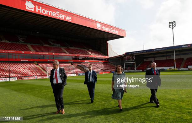 Labour Leader Keir Starmer walks on the pitch with Members of Parliament Liam Byrne and Valerie Vaz and club Chairman Leigh Pomlett during a visit of...