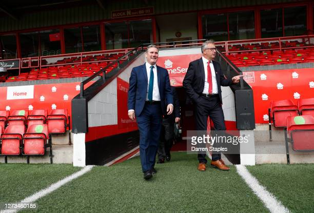 Labour Leader Keir Starmer walks out of the tunnel with Chairman Leigh Pomlett during a visit of Walsall Football Club on September 19 2020 in...