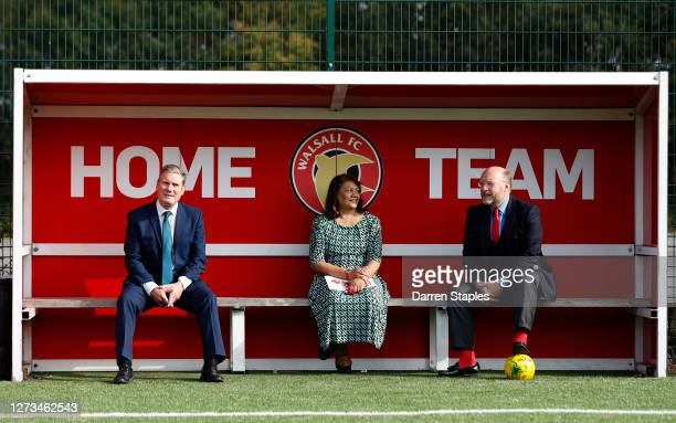 Labour Leader Keir Starmer watches a children's training session from a dugout with Members of Parliament Liam Byrne and Valerie Vaz during a visit...