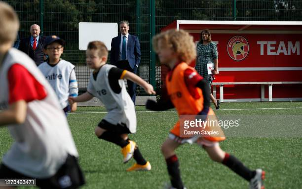 Labour Leader Keir Starmer watches a children's training session with Members of Parliament Liam Byrne and Valerie Vaz during a visit of Walsall...