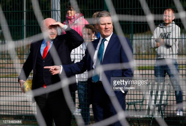 Labour Leader Keir Starmer watches a children's training session with Member of Parliament Liam Byrne during a visit of Walsall Football Club on...